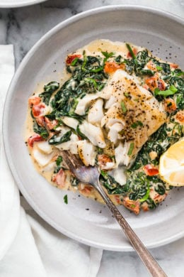 This easy Fish Florentine recipe, made with a pan seared firm white fish served on a creamy bed of spinach feels like something you would order out in a fancy restaurant!