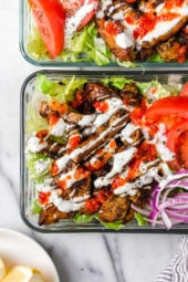Halal Food Cart inspired chicken served over a big salad of lettuce and tomatoes drizzled with a yummy white sauce.