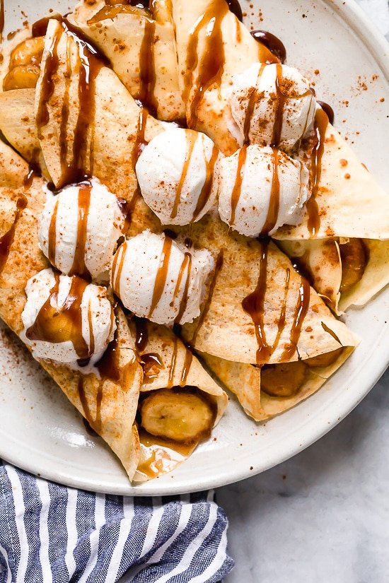 Banana Foster Crepes combine two of my favorite desserts – homemade crepes and bananas fosters! This slimmed down make-over is delicious and perfect anytime you're craving something sweet!