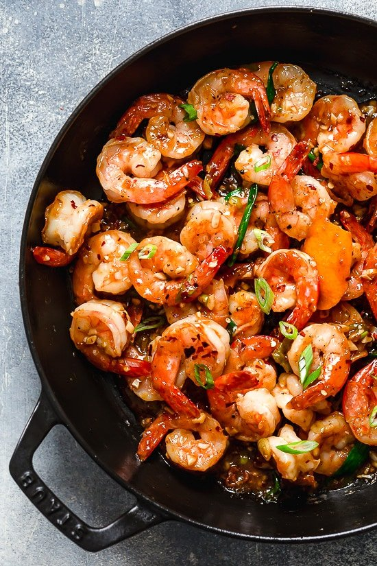 For a quick and easy weeknight stir-fry, you will love this Asian honey garlic shrimp recipe! It's sweet, spicy, savory, and so good!!