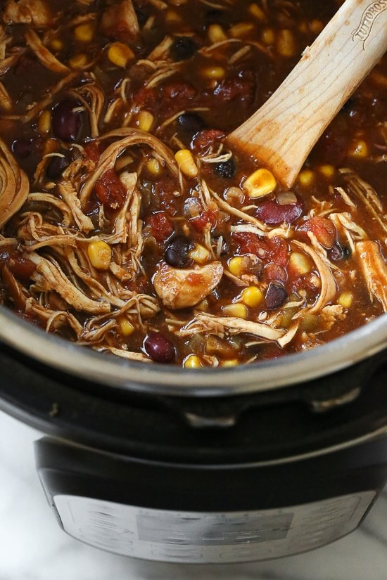 Chicken Taco Chili, made with chicken, beans, corn and tomatoes seasoned with taco seasoning is one of my most popular slow cooker recipes, which I just remade for Instant Pot after several requests! This recipe couldn't be easier, made with ingredients you probably already have in your pantry.