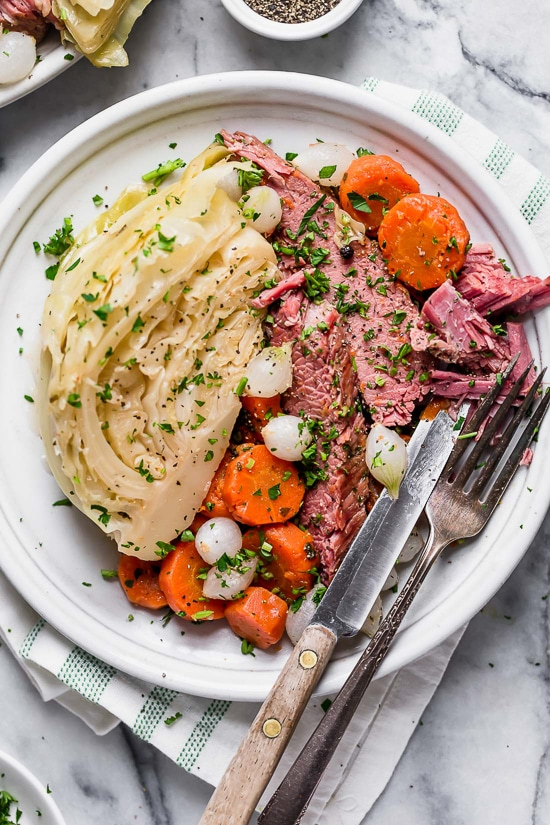 This easy Instant Pot Corned Beef and Cabbage recipe, made with beef brisket, cabbage and carrots comes out so tender and delicious! Perfect for St Patrick's Day!