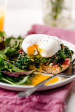 I love this lighter take on Eggs Benedict made with Canadian bacon, Swiss chard and poached eggs on a whole wheat English muffin. Perfect for breakfast or brunch!