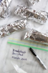 These freezer breakfast burritos, stuffed with scrambled eggs, scallions, bell pepper, bacon and cheese, are a great way to start the day! Make them ahead and freeze them for meal prep so you can have them ready any day of the week.