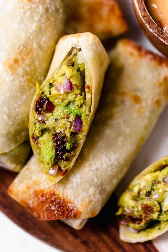 These Avocado Egg Rolls are inspired by the Cheesecake Factory egg rolls, only healthier because they are not fried. An easy air fryer recipe or bake them in the oven!