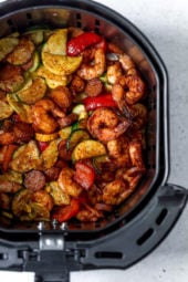 This fast and easy Air Fryer Cajun Shrimp recipe is a meal-in-one, made with shrimp, sausage, and lots of colorful vegetables such as zucchini, yellow squash and bell peppers.