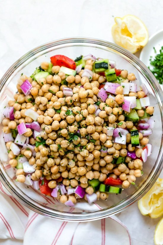 Chickpeas tossed with tomatoes, cucumbers and red onion.