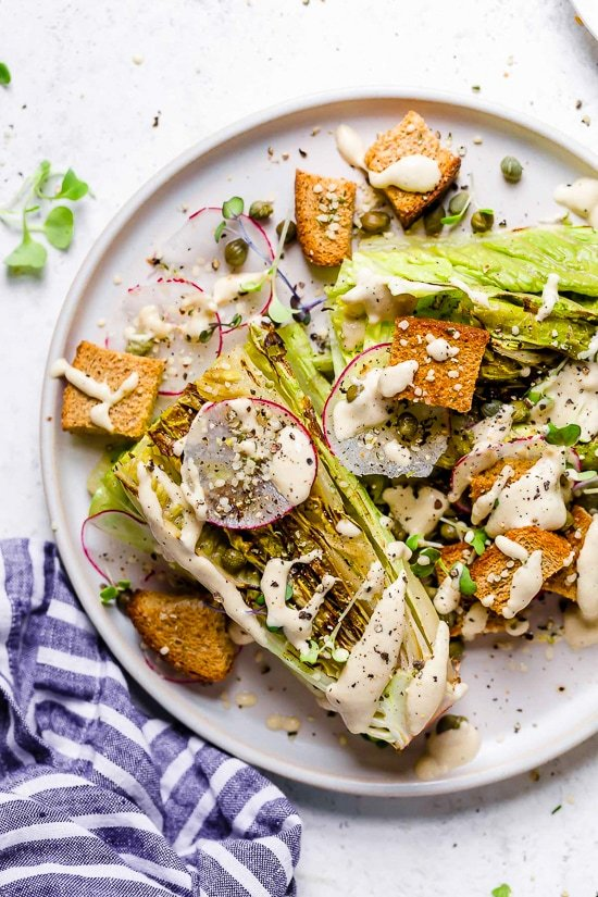 This Vegan Caesar Salad is delicious! The Caesar Salad dressing is made with raw cashews to make it creamy along with lemon juice, Dijon, garlic and capers.