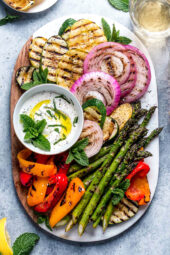 Grilled Vegetables with Yogurt Mint Sauce is so colorful and delicious. An easy summer side dish made with asparagus, zucchini, squash, red onion and bell peppers.