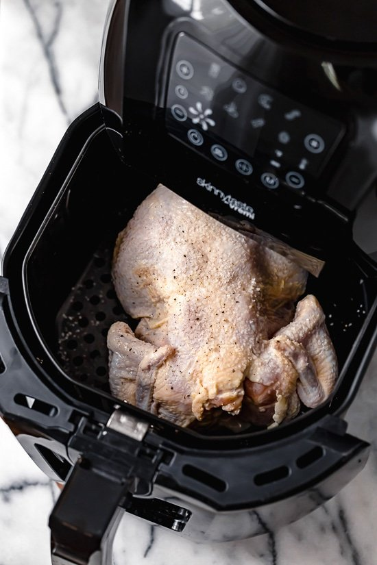 This Buttermilk-Marinated Air Fryer Whole Roasted Chicken comes out unbelievably juicy and delicious. It's so easy to make, just 3 ingredients!