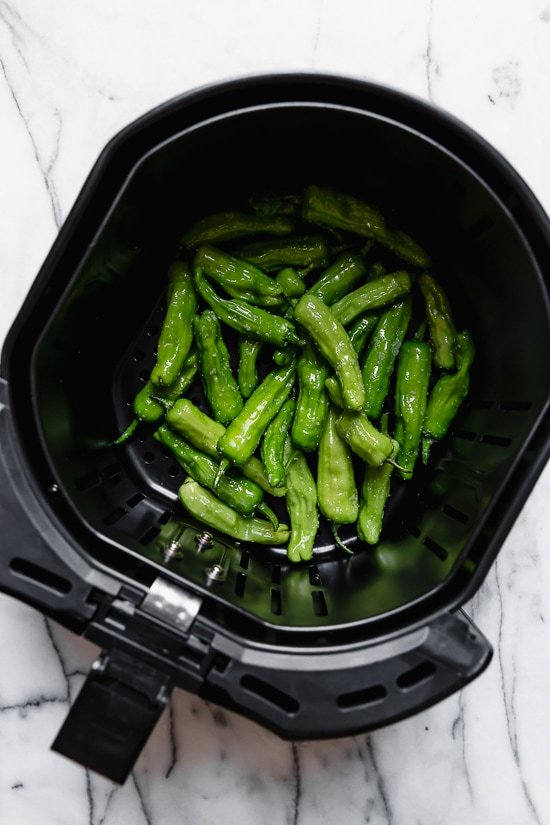 Blistered Shishito peppers are usually stir-fried in a wok or skillet. Since you're using less oil in the air fryer, these are much healthier, less messy and so easy!