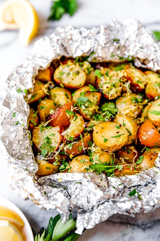 Lemon-Parsley Potato Foil Packets can be grilled or baked in the oven! A delicious side dish, and the best part – easy cleanup!