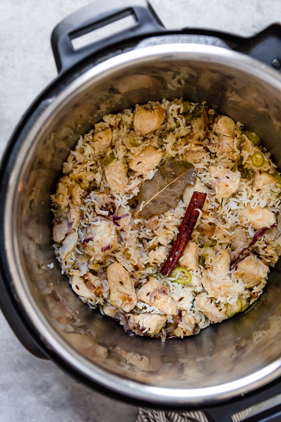 Instant Pot Indian Chicken Pulao is a lighter cousin of chicken biryani, a great gateway dish for someone new to Indian food. Similar to a rice pilaf only with chicken and aromatic spices.