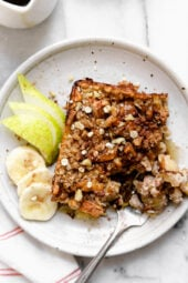 Baked oatmeal is like having dessert for breakfast! Made with healthy ingredients—bananas, pears, oats, nuts and maple syrup, it will leave you satisfied all morning.