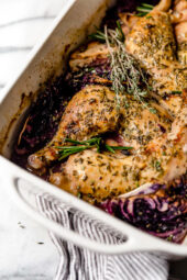 Baked Apple Cider Chicken and Cabbage is the perfect one-pot fall dish made with cider-marinated chicken, red cabbage and apples.