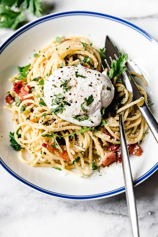 Spaghetti Carbonara is an Italian pasta dish made with bacon or pancetta, egg, black pepper and a blend of Pecorino Romano and Parmigiano-Reggiano.
