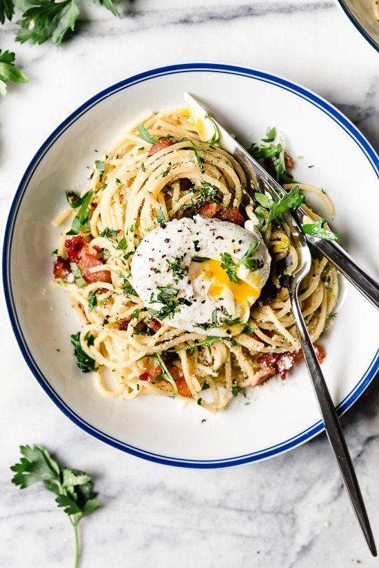 Spaghetti Carbonara is an Italian pasta dish with creamy egg, diced bacon, grated cheese, and copious amounts of black pepper–a Roman dish reminiscent of an American breakfast.