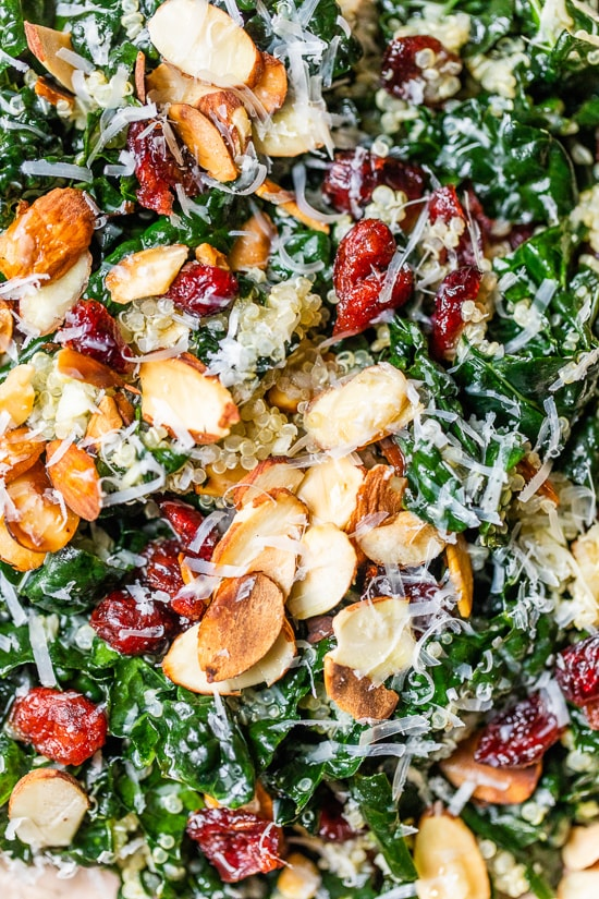 This hearty, fall Kale Salad with Quinoa and Cranberries is made even better by massaging the kale which helps break down the tough cell structure and gives the raw kale a softer texture and gentler flavor. #kalesalad #kale #skinnytaste #massagedkale