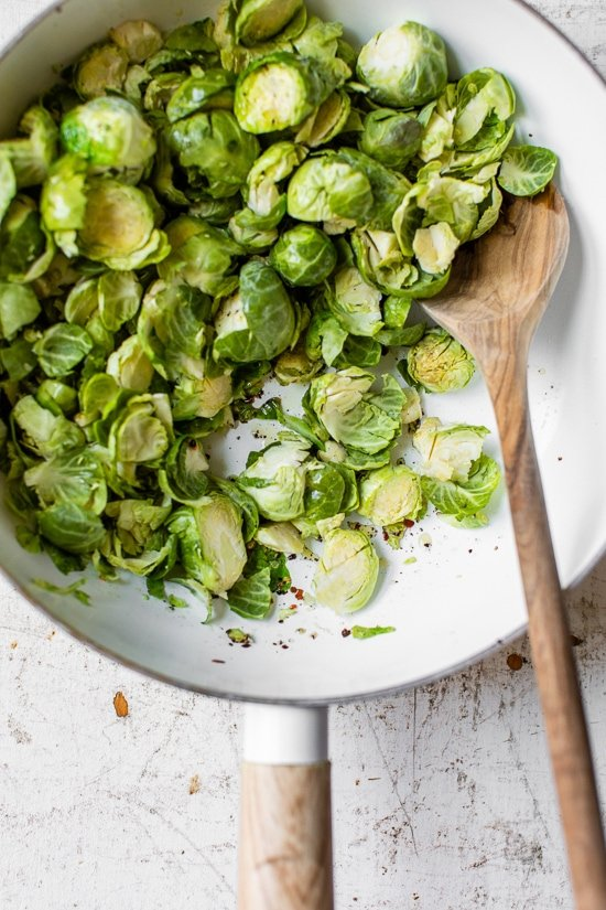 """Cacio e Pepe Brussels Sprouts swaps out pasta for shredded Brussels sprouts in this low-carb take on the Italian classic. Cacio e pepe translates from Italian to """"cheese and pepper"""" and traditionally is served as a pasta dish."""