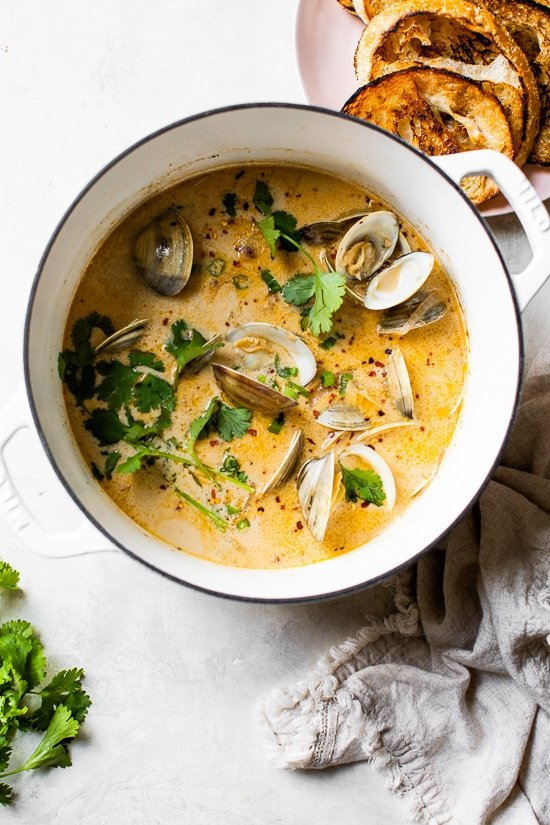 Asian Coconut Broth Clams made with lemongrass, ginger and cilantro is wonderful when paired with bread for dipping all that delicious broth!