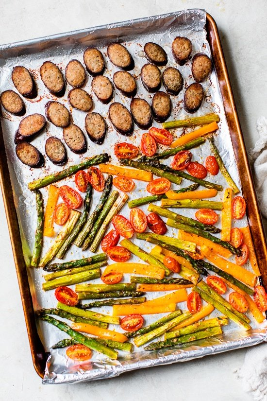 Kielbasa Veggie Sheet Pan Dinner is made with turkey kielbasa, asparagus, tomatoes and bell peppers cooked all on one pan, easy cleanup! It's also Keto, Whole30, Low Carb and Gluten-free.