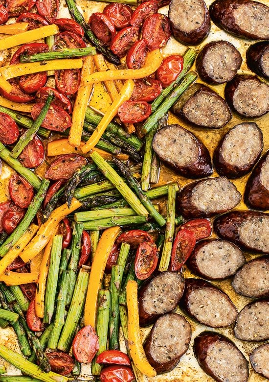 The Kielbasa Veggie Sheet Pan Dinner consists of turkey keelbasa, asparagus, tomatoes and peppers, all of which are cooked in a pan.  Easy cleaning!  It's also keto, whole30, low carb, and gluten-free.