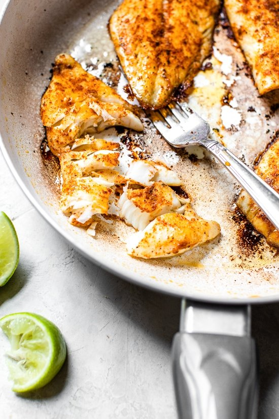 cod fish cooked in a skillet to make tacos