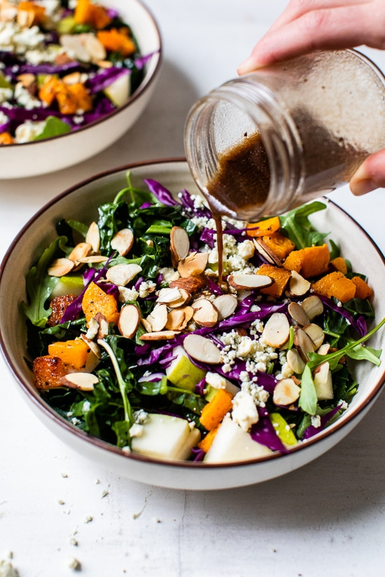 Immune-boosting kale, squash, purple cabbage, arugula, almonds, basil and pears are all tossed in a tangy-sweet dressing. To add more protein, you could add grilled shrimp or salmon.