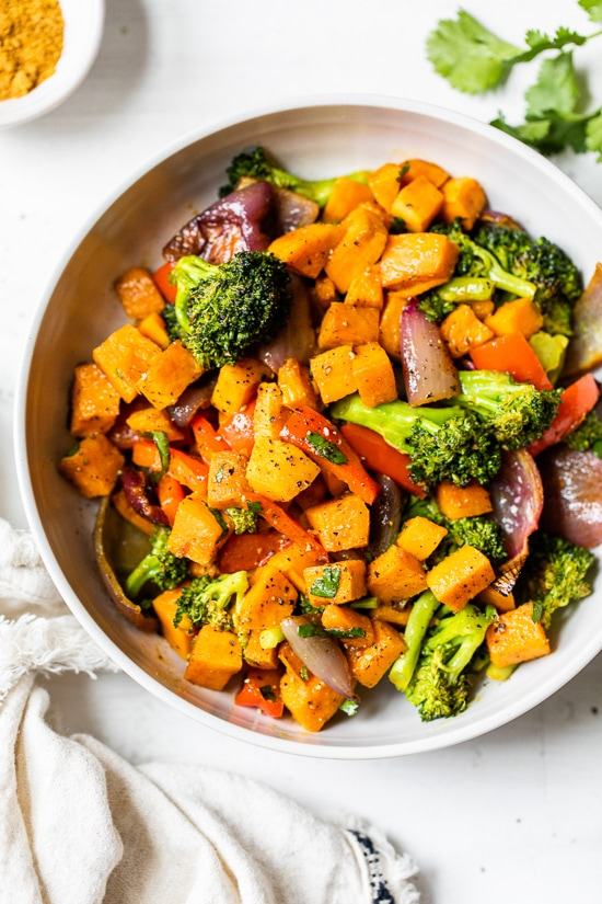 This nourishing Warm Curry Roasted Vegetable Salad with Honey Curry Dressing is a delicious vegetarian, gluten- and dairy-free dinner or make-ahead lunch.