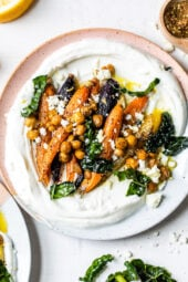 Roasted Carrots and Chickpeas seasoned with za'atar and served over Greek yogurt with lemony kale makes a wonderful side dish or meatless main!