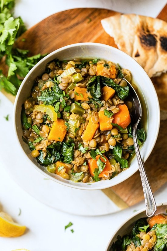 Make a large saucepan out of this healthy, vegetarian (and vegan) Lebanese lentil soup, made with green lentils, kale, sweet potatoes, lots of garlic, ginger, and lemon.