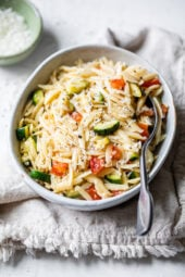 Orzo with Zucchini and Tomato is a quick and easy side dish that goes great with chicken, pork chops, or double the portion and enjoy it as a main dish.