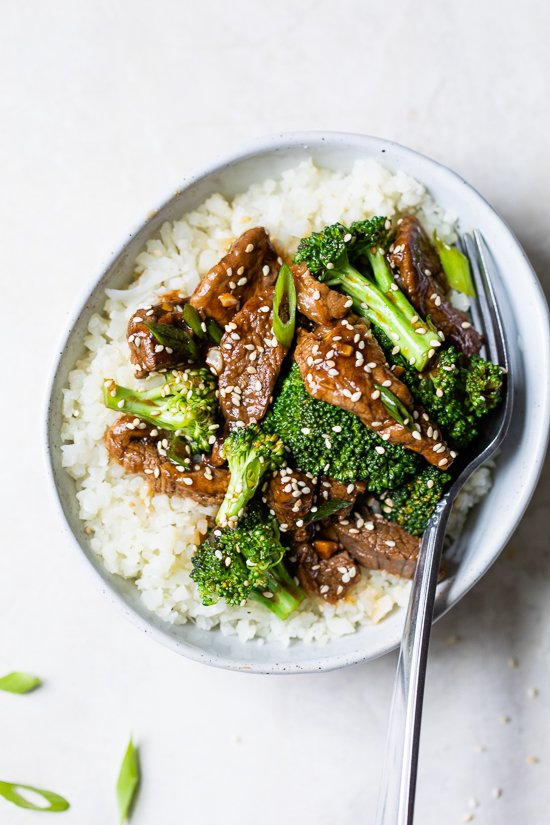 Broccoli beef in a bowl with white rice.