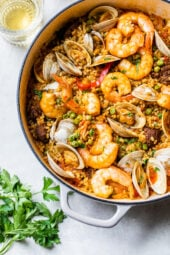 This easy seafood paella, made with shrimp, clams and chorizo is a delicious one-pot dish!