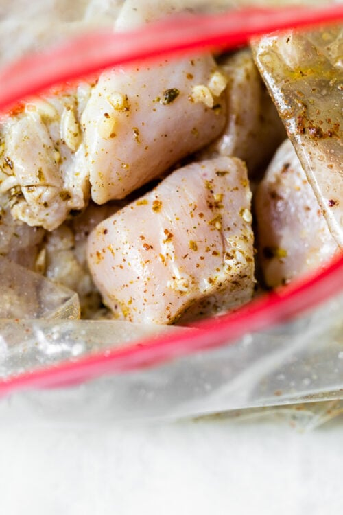 raw marinated chicken in a bag
