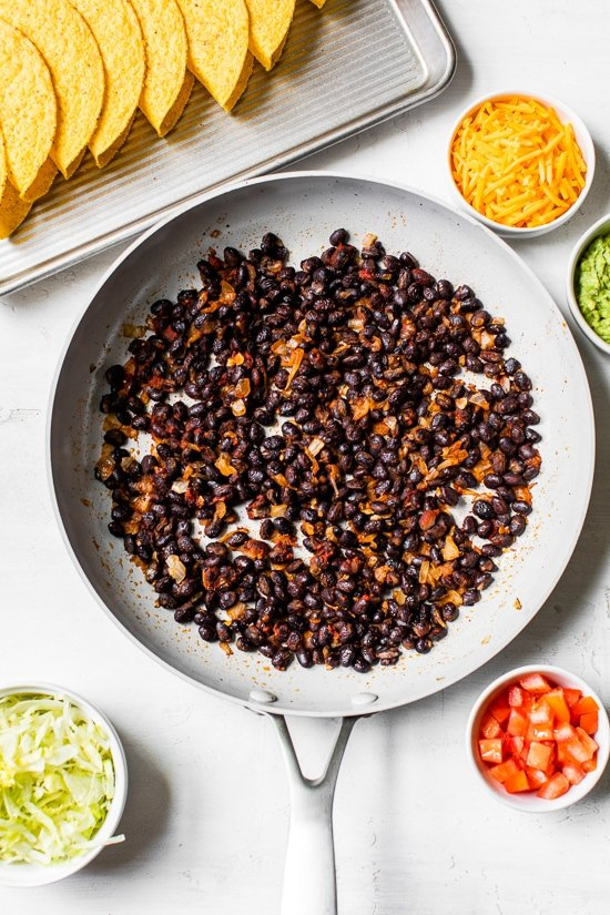 seasoned black beans in a skillet