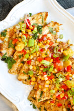 Zesty Lime Grilled Chicken with Pineapple Salsa on a platter.