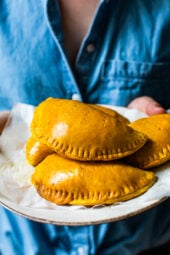 Girl holding Jamaican Beef Patties