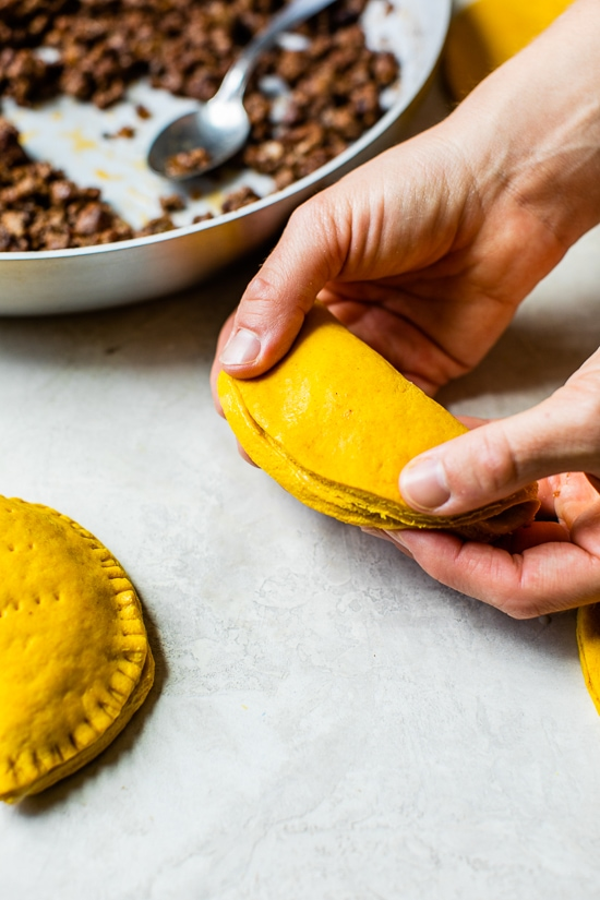 folding Jamaican Beef Patties before baking