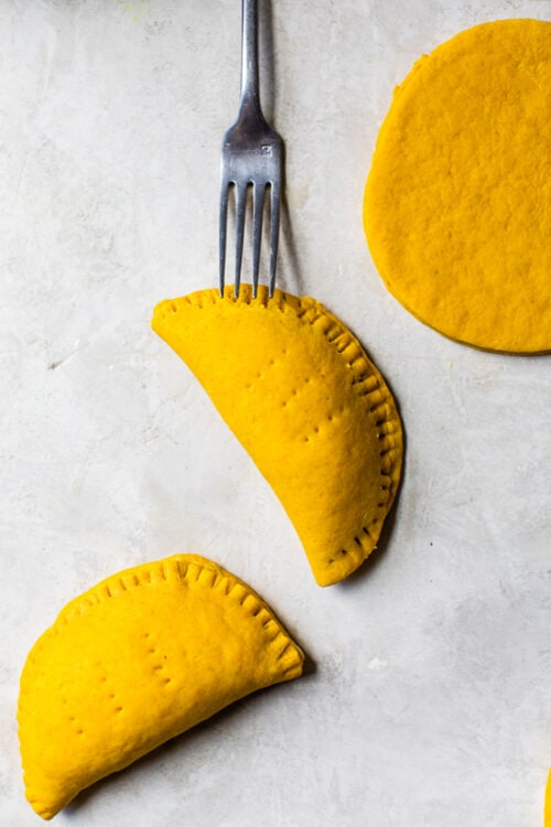 Jamaican Beef Patties with poked fork holes before baking