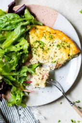 Crustless Quiche Lorraine on a plate with a fork.