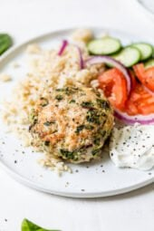 greek turkey burger on a plate with rice