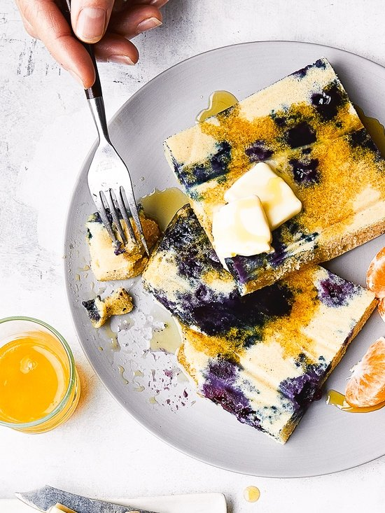 Lemon Blueberry Buttermilk Sheet Pan Pancakes on a plate with syrup.