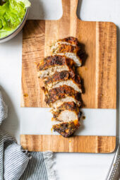 sliced chicken breast on cutting board