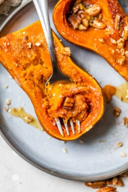 Roasting honeynut squash with a fork.