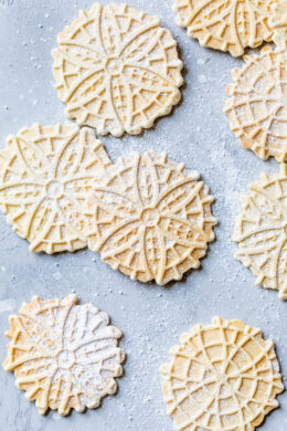 Pizzelle Cookies with powdered sugar