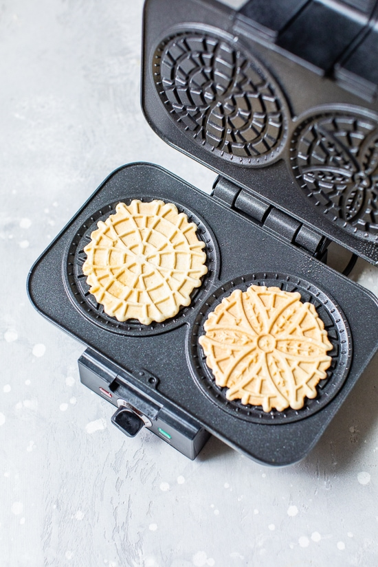 Pizzelle Cookies in a pizzelle press.
