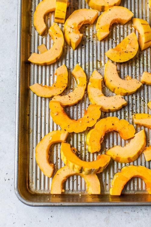 delicata squash on a sheet pan