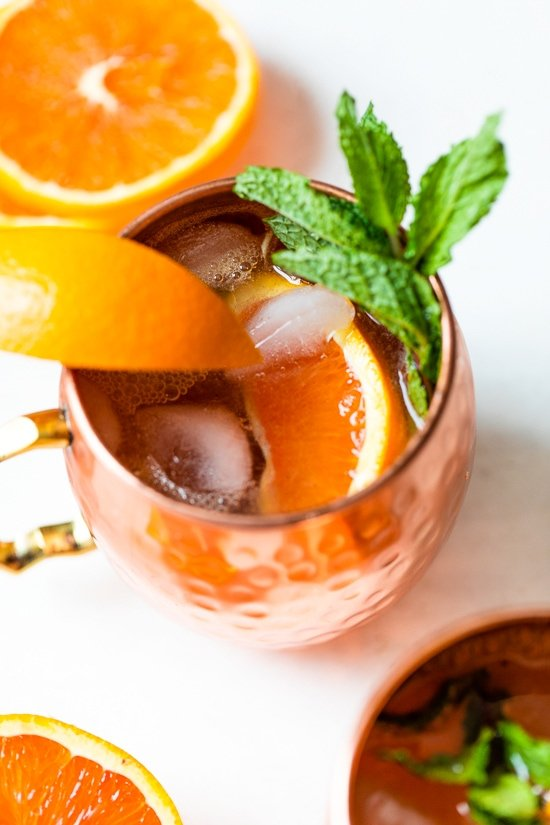 orange moscow mule in copper mugs