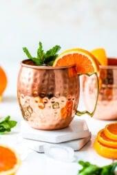 orange moscow mule in copper mugs